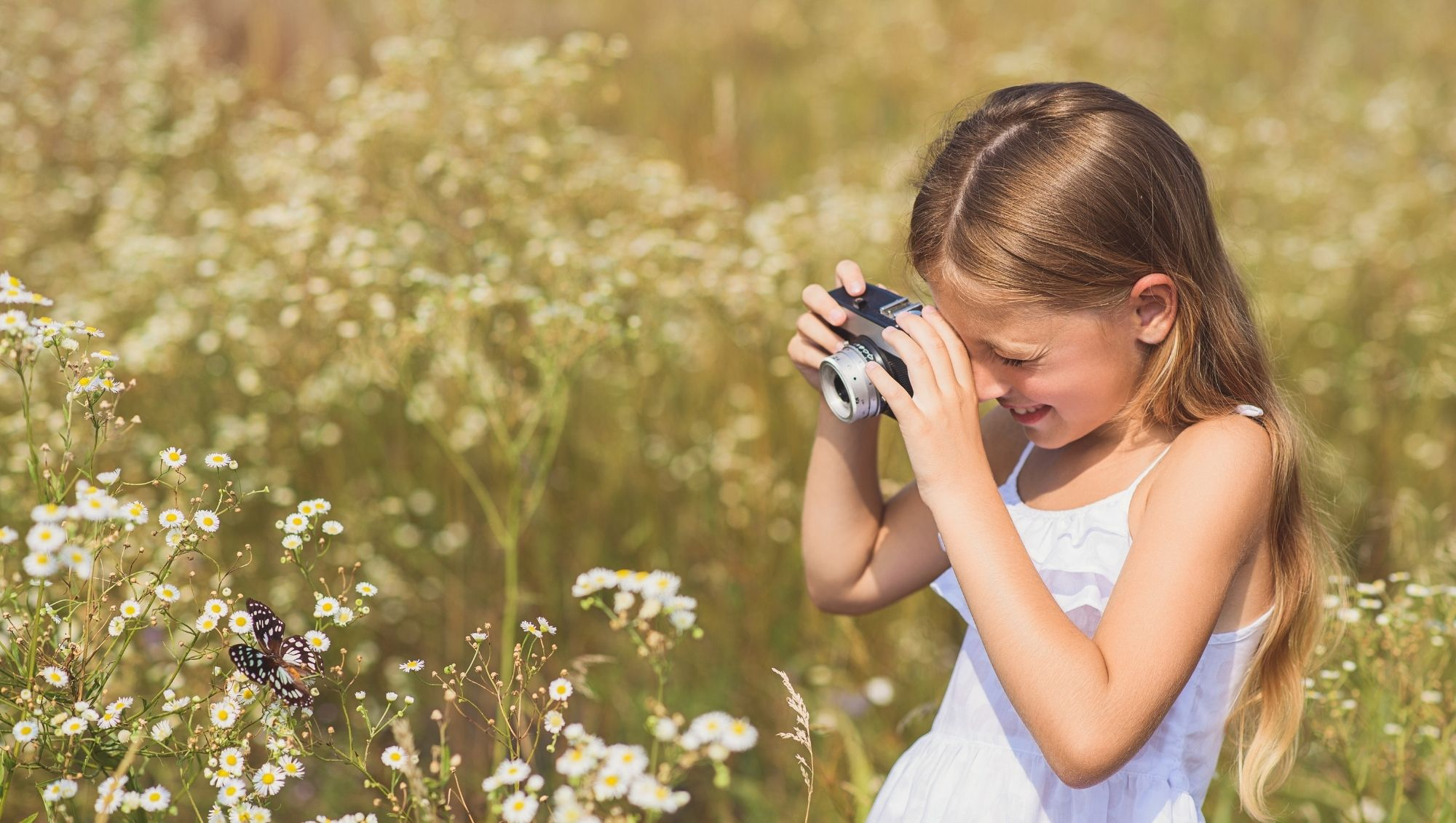 girl photographing butterfly